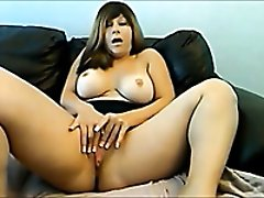 Sultry MILF with huge breasts is playing with herself on cam