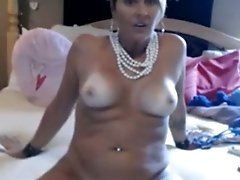 Mature beautiful blonde lady spreads her legs on webcam
