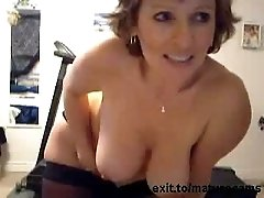 Mature busty Marie fingers on home webcam