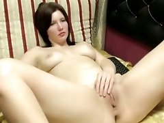 Brown haired nympho finger fucks her juicy pussy with passion