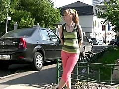Slim girl pees in her legging while walking in the street