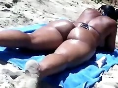 A girl with mesmerizing ass gets caught on my hidden cam on a beach