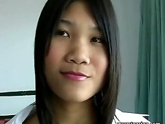 Sexy Asian teen street tramp undresses on cam in the hotel room