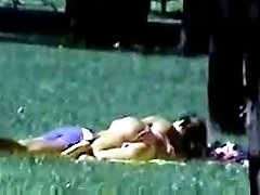 Nasty couple having a sexy time in the public park on the lawn