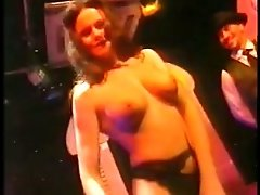 Brown-haired cutie demonstrates her boobs for the cam in a club