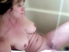 Mature and busty wife in the bath tub masturbating on cam
