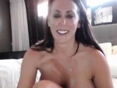 Brunette MILF big boobs undressing on social