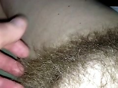 Rubbing my wife's hairy snatch in front of a camera