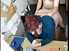A slutty fat redhead sucking and fucking at work on hidden cam