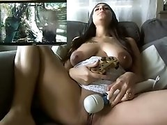 Big boobed hottie playing with her pussy while playing video games