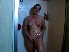 Chubby and busty wife taking shower all naked on cam