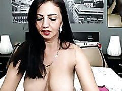 Dirty mature latina milf with big breasts masturbating on webcam