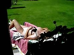 Chubby mature wife of my neighbor takes a sunbath in the backyard