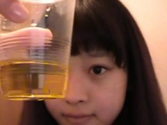 Asian teens piss in cup