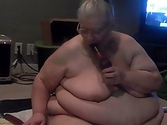 Extremely chubby disgusting old lady sucked her dildo on webcam