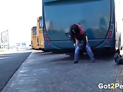 Dirty-minded brunette pulls down jeans to pee at the bus depot
