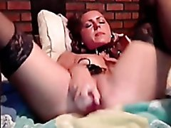 Horny and kinky milf blondie plugs a toy in her anus on webcam