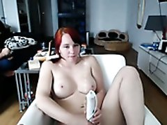 Chubby pale redhead with big boobies uses dildo to teases her pussy