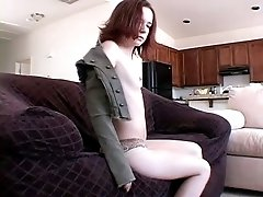 Petite redhead college girl in the khaki outfit stripteases