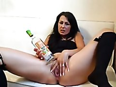 Filthy and passionate German brunette on webcam uses a bottle