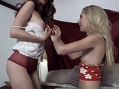 Gorgeous blond and red haired beauties suck each other's boobs on cam