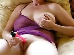 Mature bosomy wife having summer fun on the couch on cam