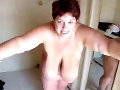 Redhead BBW cougar wife with huge natural tits posing naked on cam