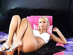 Gorgeously hot blonde webcam beauty is having fun with her big black dildo