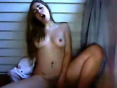 Sensual brown-haired teen rubs her pussy to orgasm in webcam solo vid