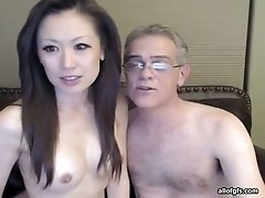 Asian hottie shows her holes for the cam and lets a man eat them