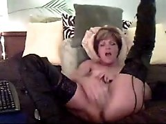 Mature mommy fondles her wet pussy in front of the camera
