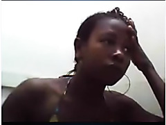 Black bitch showing wazoo on webcam