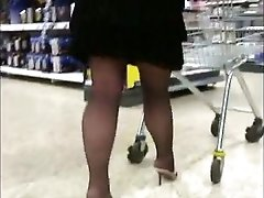 Her sexy black pantyhose legs and mini skirt drive me crazy