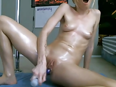 Skinny blond with sexy ass works pussy with big toy #2