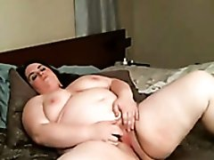 Extremely chubby slutty fatty with huge melons masturbate her wet cunt