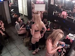 Enjoy watching sexy strippers getting ready to work