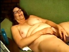 Horny old lady in glasses just loves masturbating on camera
