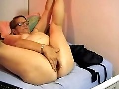 Mature short haired lady on webcam undresses and masturbates