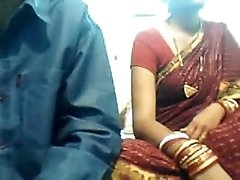 Indian woman shows her tits for the webcam and sucks her man's dick