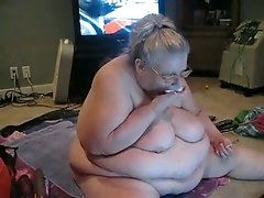 Ugly as shit fat perverted mature bitch sucks lollipop on webcam