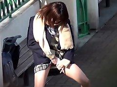 Asian teens in uniform pee outdoors