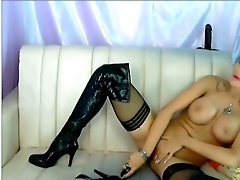 Torrid MILF in leather clothes shows off her fake D cups on webcam