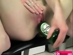 Horny chick puts beer bottle in shaved pussy
