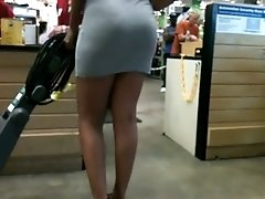 This fat ass ebony chick is wearing a tight dress to underline her butt