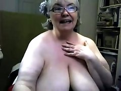 Blonde granny plays with her natural jugs in front of a webcam