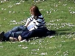 Amateur redhead girl jacks off her bf's dick in park - spy cam