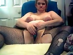 Ugly bitch with swollen nipples masturbates on cam