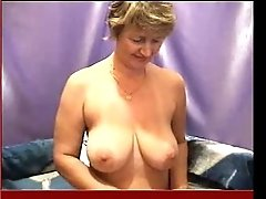 Classy mature webcam whore shows me her big round saggy boobies