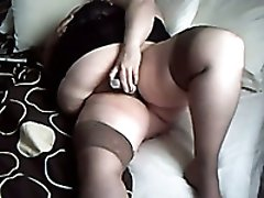 Chubby amateur white lady in stockings masturbates on webcam