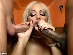 Lewd blonde Kelly Lenox poses on a cam and gives hot blowjob in a threesome fuck video